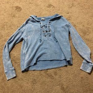 Distressed blue lace up crop sweatshirt
